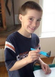 homeschooling, boy holding owl pellet